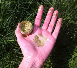 gold glitter on locations of hand and finger chakras
